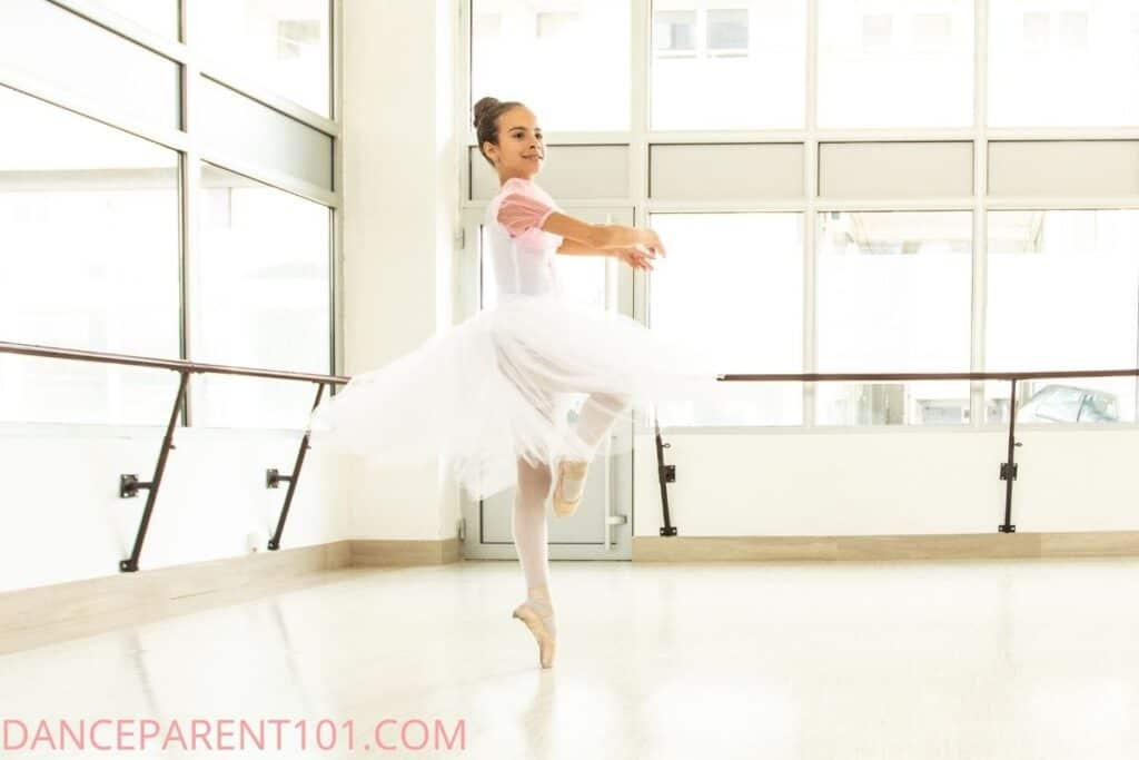 Young dancer on pointe pirouette